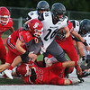 Carl Junction's Colton Kennedy (22) and Blake Batagglia (26) tackle Willard's Garrett Rice during Friday's game in Carl Junction.<br /> Globe | Roger Nomer