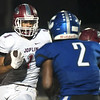 Joplin's Zach Westmoreland (1) looks to get past Carthage defensive back Trulyn Kendrick (2) during their game on Friday night at Carthage.<br /> Globe | Laurie Sisk