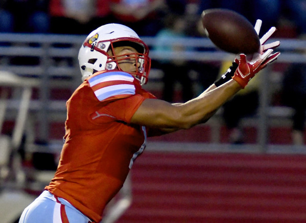 Webb City receiver Terrell Kabala secures the second of his two first quarter touchdown receptions during the Cardinals game against Carthage on Friday night at Cardinal Stadium.<br /> Globe | Laurie Sisk