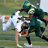 Fort Hays State's Harley Hazlett (87) dives for extra yards as Missouri Southern's Akel Beard (21) and Deshon Cowling (2) defend during their game on Saturday night at MSSU.<br /> Globe | Laurie Sisk