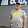 Carthage High School track coach Andy Youngworth stands near some of his team's accolades on Wednesday at Carthage High School.<br /> Globe   Laurie SIsk