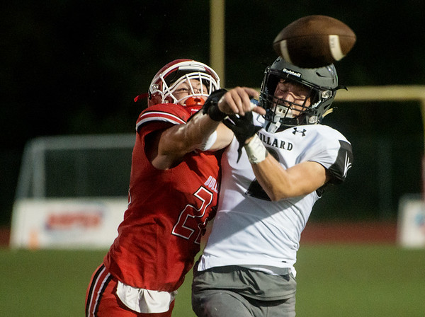 Carl Junction's Colton Kennedy knocks a pass away from Willard's Kohlbe Bean during Friday's game in Carl Junction.<br /> Globe | Roger Nomer