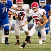 Grove's Nick Estrada (2) gets past several of Miami's Wardogs defenders for a gain of yards during their game on Friday evening at the Red Robertson Field in Miami OK.<br /> Globe | Israel Perez
