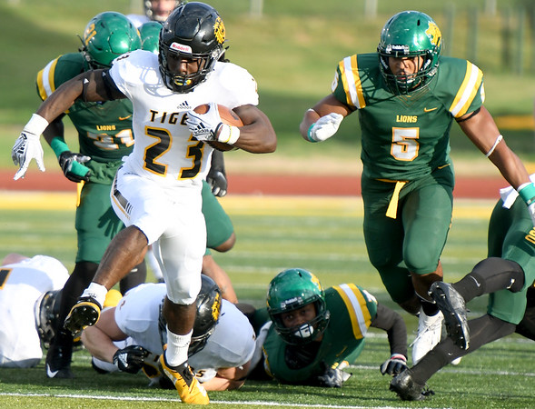 Fort Hays State's Charles Tignor(23) breaks free for a long touchdown run as Missouri Southern's Akel Beard (21) and Richard Jordan, Jr. (5) give chase during their game on Saturday night at MSSU.<br /> Globe   Laurie Sisk