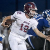 Jopplin quarterback Blake Tash (12) looks for room up the middle during the Eagles game against Carthage on Friday night at Carthage.<br /> Globe | Laurie Sisk