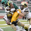 Missouri Southern's Shemar Coleman (17) tries to get past Lindenwood's Lloyd Lockett (47) and Zach Turnure (25) during the Lions home opener on Saturday at Fred G. Hughes Stadium.<br /> Globe | Laurie Sisk