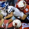 Webb City defensive back Cole Gayman (10) brings down Carthage's Tucker Downing (3) during their game on Friday night at Cardinal Stadium.<br /> Globe | Laurie Sisk