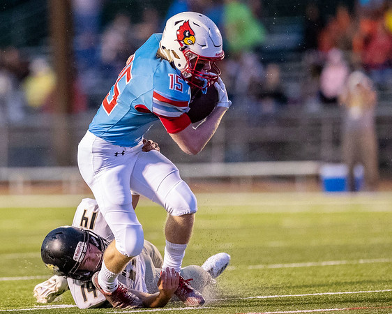 Globe Israel Perez<br /> Cale McCallister (15) of Webb City fights the tackle of Quincey Willis (14) of Neosho for extra yards during their game on Friday night at Cardinal Stadium.