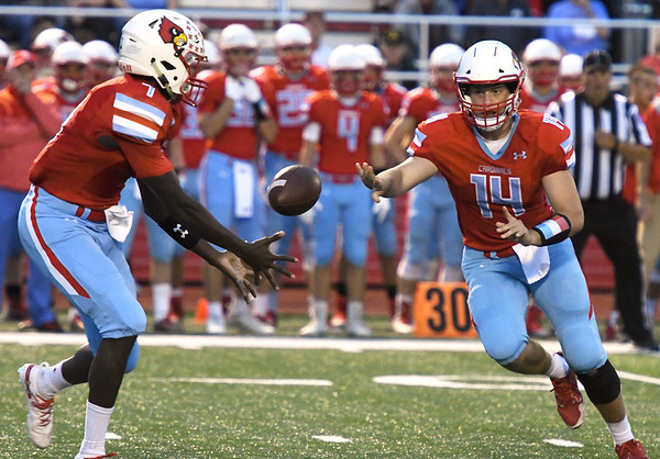 Webb City quarterback Cole Beason (14) pitches to runningback Durand Henderson (7) during their game against Carthage on Friday night at Cardinal Stadium.<br /> Globe | Laurie Sisk