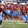 Webb City quarterback Cole Beason (14) pitches to runningback Durand Henderson (7) during their game against Carthage on Friday night at Cardinal Stadium.<br /> Globe   Laurie Sisk