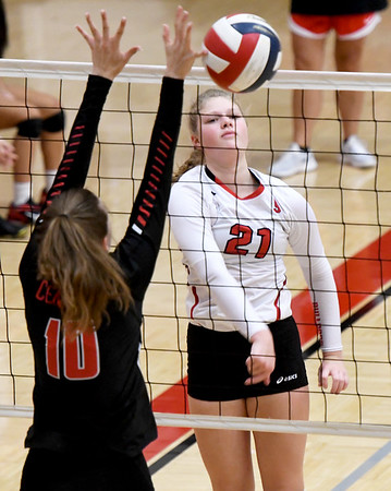 Carl Junction hitter Jillian Kennedy (21) gets a spike past Springfield Central blocker Maddie Dimmick during their match on Saturday at the Dr. Jeffrey Knutzen CJ Classic Volleyball Tournament at CJHS.<br /> Globe | Laurie Sisk