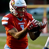 Webb City receiver Terrell Kabala secures the first of his two first quarter touchdown receptions during the Cardinals game against Carthage on Friday night at Cardinal Stadium.<br /> Globe | Laurie Sisk