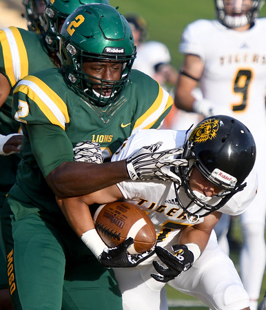 Fort Hays receiver Manny Ramsey (17) works to get past Missouri Southern's Deshon Cowling (2) during their game on Saturday night at MSSU.<br /> Globe   Laurie Sisk