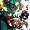 Fort Hays receiver Manny Ramsey (17) works to get past Missouri Southern's Deshon Cowling (2) during their game on Saturday night at MSSU.<br /> Globe | Laurie Sisk