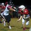 Seneca's Gavin Clouse gets away from Lamar's Morgan Davis during Friday's game in Seneca.<br /> Globe | Roger Nomer