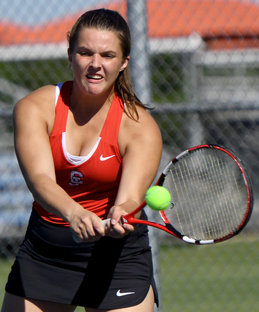 Carl Junction's Taylor Storm returns a serve during her no. 1 doubles match against Webb City on Thursday at the Joplin Athletic Complex.<br /> Globe   Laurie Sisk