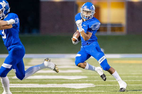 Miami's Damion Burris (13) runs the ball for a gain of yards against Grove OK during their game on Friday evening at the Red Robertson Field in Miami OK.<br /> Globe | Israel Perez
