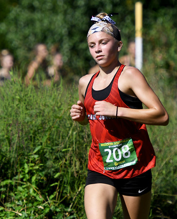 Carl Junction's Ally Montez runs near the front of the pack during the high school girls race at the Missouri Southern Stampede on Saturday at MSSU.<br /> Globe   Laurie Sisk