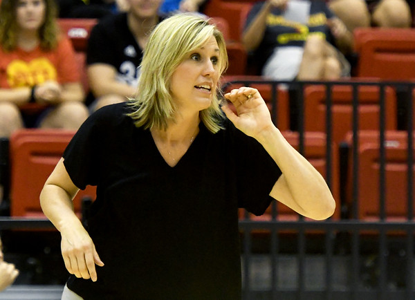 Pittsburg State volleyballl coach Jen Gomez, center, instructs her team on Tuesday night against Central Oklahoma at John Lance Arena.<br /> Globe | Laurie SIsk