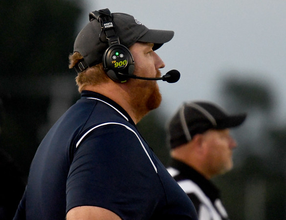 Joplin Coach Curtis Jasper watches from the sideline as his team gives him his 100th career victory on Friday night at Neosho.<br /> Globe | Laurie Sisk