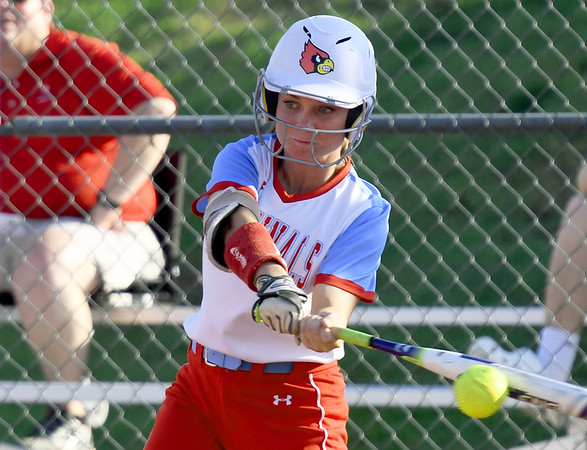 Webb City's Renae Gillmore connects for a third-inning single during the Cardinals game against Nixa on Thursday night at WCHS.<br /> Globe | Laurie Sisk