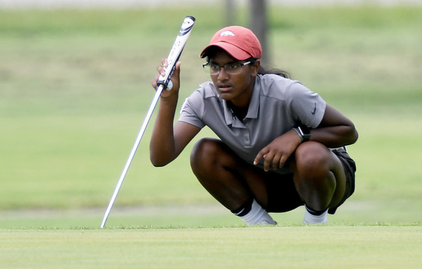 Carl Junction's Jenna Teeter lines up a putt on the no. 17 green on Wednesday at Schifferdecker.<br /> Globe | Laurie Sisk