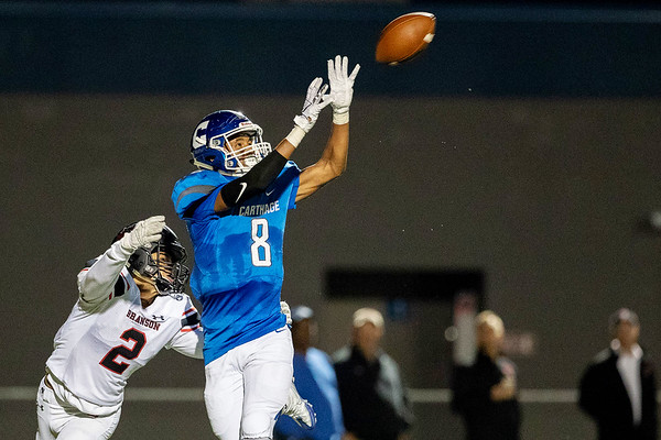 Globe Israel Perez<br /> Carthage's Dagan Sappington (8) makes a pass reception for a first and goal as Branson's DShawn Craigg (2) tackles from behind their match on Friday night at Carthage High School