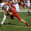 Carl Junction's Noah Southern tackles Nixa's Hunter Crabtree during Friday's game in Carl Junction.<br /> Globe | Roger Nomer