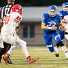 Miami's Caden Folks (23) runs the ball as he looks for a way past Grove's defender Jonas Chaney (20) during their game on Friday evening at the Red Robertson Field in Miami OK.<br /> Globe | Israel Perez