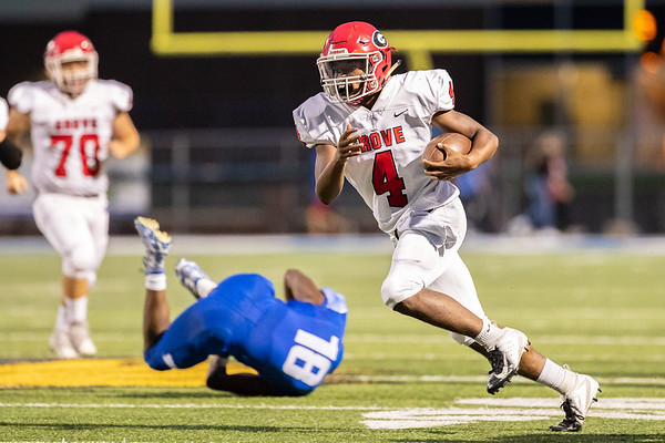 Grove's Greg McCurdy (4) runs the ball for a gain of yards against Miami's Wardogs during their game on on Friday evening at the Red Robertson Field in Miami OK.<br /> Globe | Israel Perez