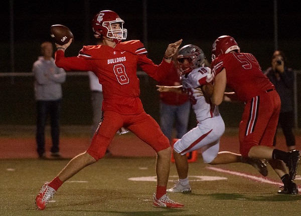 Carl Junction's Alex Baker drops back to pass during Friday's home game against Nixa.<br /> Globe | Roger Nomer