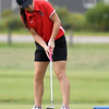 McDonald County's Lilly Allman watches her putt on the no. 17 green on Wednesday at Schifferdecker.<br /> Globe | Laurie Sisk