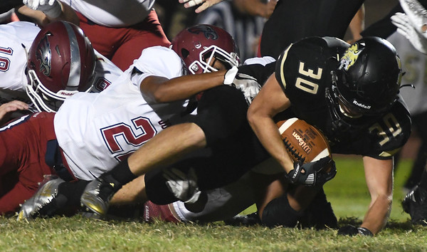 Joplin's Simeon Barba (22) brings down Neosho's Donnie Fox (30) during their game on Friday night at Neosho.<br /> Globe   Laurie Sisk