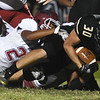Joplin's Simeon Barba (22) brings down Neosho's Donnie Fox (30) during their game on Friday night at Neosho.<br /> Globe | Laurie Sisk