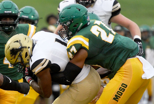 Missouri Southern's Justin Legier (27) works to bring down Lindenwood's Cameron Sanders (1) during the Lions home opener on Saturday at Fred G. Hughes Stadium.<br /> Globe | Laurie Sisk