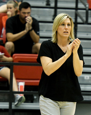 Pittsburg State volleyballl coach Jen Gomez, center, encouarges her team as her husband, Chanc Gomez watches from the stands on Tuesday night at John Lance Arena.<br /> Globe | Laurie SIsk