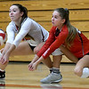 From the left: Carl Junction's Salma Lewis and Loran Dawson track down a spike during their match against Springfield Central on Saturday at the Dr. Jeffrey Knutzen CJ Classic Volleyball Tournament at CJHS.<br /> Globe   Laurie Sisk