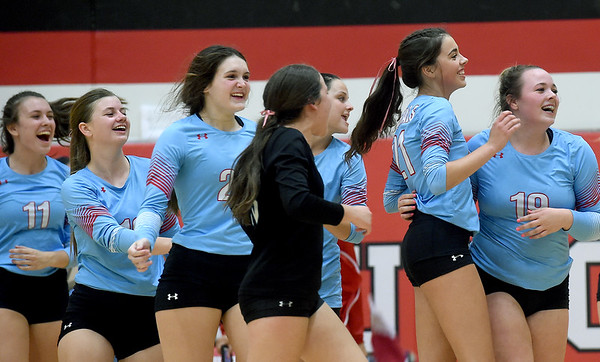 The Webb City volleyball team celebrates after defeating Carthage and capturing first place in the Dr. Jeffrey Knutzen CJ Classic on Saturday at Carl Junction High School.<br /> Globe   Laurie Sisk