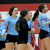 The Webb City volleyball team celebrates after defeating Carthage and capturing first place in the Dr. Jeffrey Knutzen CJ Classic on Saturday at Carl Junction High School.<br /> Globe | Laurie Sisk