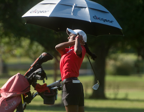 Carl Junction's Jenna Teeter hits onto the green during Monday's Central Ozark Conference at Carthage Municipal Golf Course.<br /> Globe | Roger Nomer