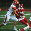 Carl Junction's Brady Sims pushes away Republic's Evan Smith during Friday's game in Carl Junction.<br /> Globe | Roger Nomer