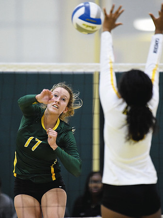Missouri Southern's Janelle Brehm (17) logs a kill as Cameron's Riana Blount (8)  attempts a block during their match on Saturday at Leggett & Platt.<br /> Globe | Laurie Sisk
