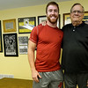 Pittsburg State linebacker Chase Johnston stands next to his grandfather, former Green Bay Packer Nelson Toburen on Thursday amid memorabilia at Toburen's Pittsburg home.<br /> Globe | Laurie Sisk
