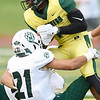 Missouri Southern's Charles West (1) tries to get past Northwest Missouri State's Blake Bayer during their game on Saturday night at Fred G. Hughes Stadium.<br /> Globe | Laurie Sisk