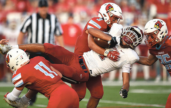 Webb City's Treghan Parker (11,) Sergio Perez (3) and Brayden Bond (36) work to bring down Joplin's Zach Westmoreland (1) during their game on Saturday night at Webb City.<br /> Globe | Laurie Sisk