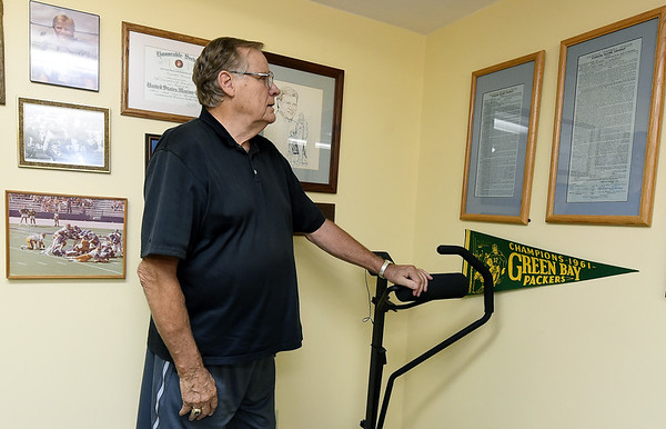 Former Green Bay Packer Nelson Toburen stands beside his original NFL contract on Thursday at his Pittsburg home.<br /> Globe   Laurie Sisk