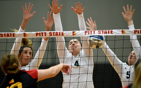 Pittsburg State's Claire Sandvig (10) gets a spike past Missouri Southern's Alyssa Diaz (16), Alicia Pickett (4) and Shaylon Sharp (5) during their match on Tuesday night at PSU.<br /> Globe | Laurie Sisk