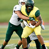 Missouri Southern's Keandre Bledsoe (85) tries to get past Northwest's Jackson Barnes (49) as his teammate Jerrell Green asists on the play during their game on Saturday night at Fred G. Hughes Stadium.<br /> Globe | Laurie Sisk