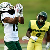 Northwest Missouri State receiver Imani Donadelle (19) pulls down a pass for a 68-yard touchdown on the Bearcats second play from scrimmage as Missouri Southern's JaTece Wright looks on during their game on Saturday night at Fred G. Hughes Stadium.<br /> Globe | Laurie Sisk