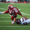 Joplin's Isaiah Davis is pulled down by Branson's Nathan Woodmansee during Friday's game at Joplin.<br /> Globe | Roger Nomer
